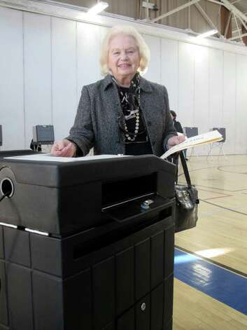 Kaye Barker casts her ballot at Town Hall Tuesday afternoon. Photo: File Photo / Darien News