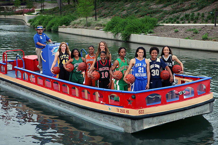 Super Team members (from left): Cheyenne Berry of Lytle, Shana Holmes of Southwest, Charlicia ?CeCe? Harper of Madison, Jessica Kuster of Reagan, Len?Nique Brown of Wagner, Kiante Ageous of Sam Houston, Erica Donovan of Jay, Jackie Woods of Holy Cross and Player of the Year Meighan Simmons of Steele (not pictured is Arielle Roberson of Wagner).