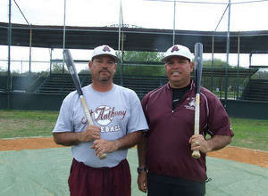 Identical twins Ed (left) and Ray Solis were baseball teammates in high school, college and summer clubs in their playing days. Now, Ed is head coach and Ray is a varsity assistant and junior varsity coach at St. Anthony High School.