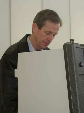 William Green concentrates as he fills out the voting ballot at Town Hall Tuesday afternoon. Photo: File Photo / Darien News