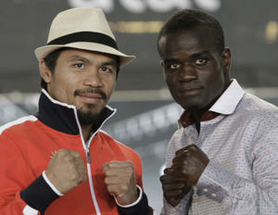 Manny Pacquiao (left) has won 11 straight going into tonight's fight against Joshua Clottey at Cowboys Stadium. Clottey has never been knocked out in 38 bouts.