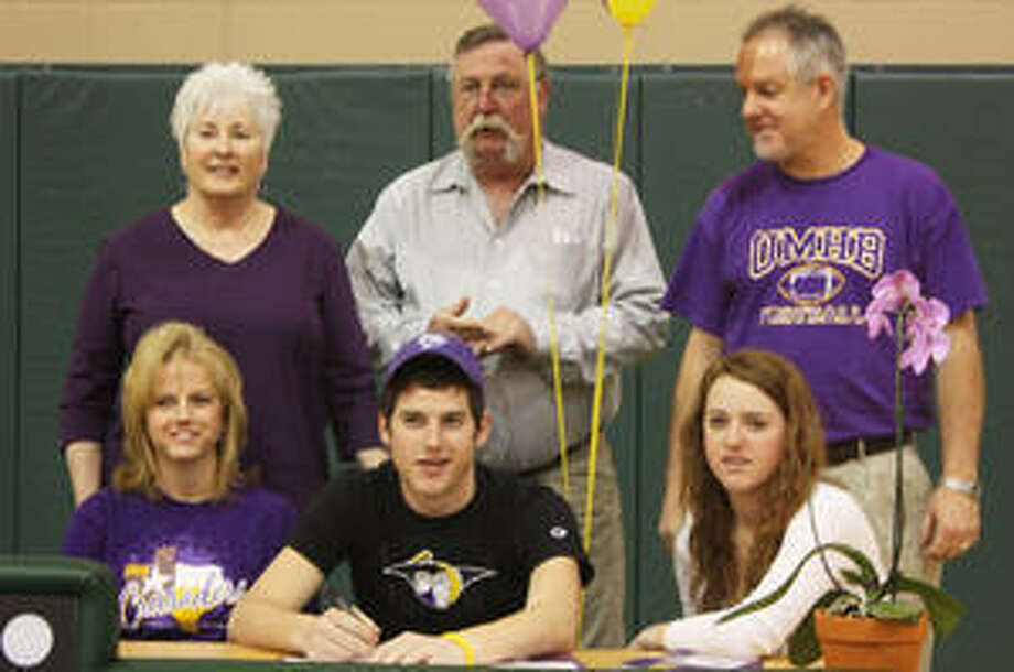Canyon Lake High's All-State football player Eric Nelson on March 10 signed to play at Mary Hardin-Baylor. Pictured are (top row, l-r) her grandparents, Sabina and Philip Neal and her father Mile Nelson. In the bottom row, left to right, are his mother, Marion, Nelson and his sister, Jessica.