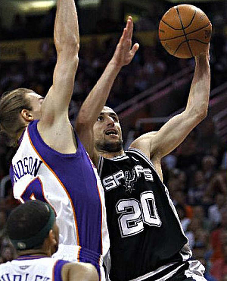 Spurs guard Manu Ginobili drives to the basket past Phoenix defenders Louis Amundson and Jared Dudley.