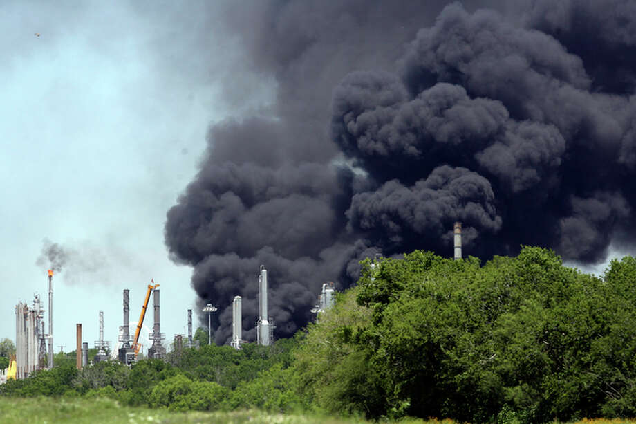 A black plume of smoke was visible 40 miles away as firefighters are trying to control a two-alarm blaze raging at AGE Refining Inc., a fuel refinery on the city's South Side on Wednesday, May 5, 2010. / jdavenport@express-news.net