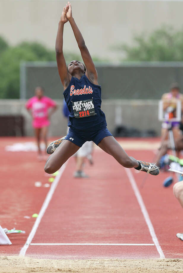 Laura Oseghae of Brandeis competes in the 5A girls long jump. She took first place with a jump of 18-feet, 10-3/4 inches. / San Antonio Express-News