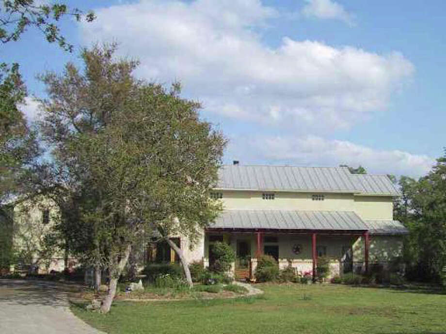 Two-story, 11-year-old home with a garage apartment on 41/2 acres in the Cibolo Ranch Estates subdivision in Boerne, owned by Kim Young and Kelly Young.