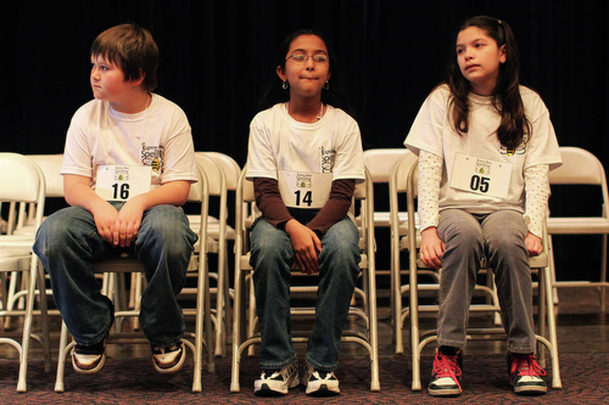 Contestants, from left, Keaton Weissmiller, Sanjana Ramchandran, and Grecia Sanchez wait for their 42 finalist competitors to take their seats at the Express-News' 57th Annual Regional Spelling Bee at Laurie Auditorium, Saturday, March 6, 2010. Jennifer Whitney/ special to the Express-News