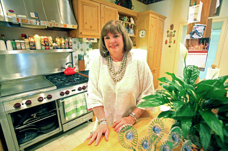 NIOSA chairwoman Nancy Hamner Avellar says the best thing about her kitchen is the commerical Wolf stove, which she has vowed to never be without. / © 2010 San Antonio Express-News