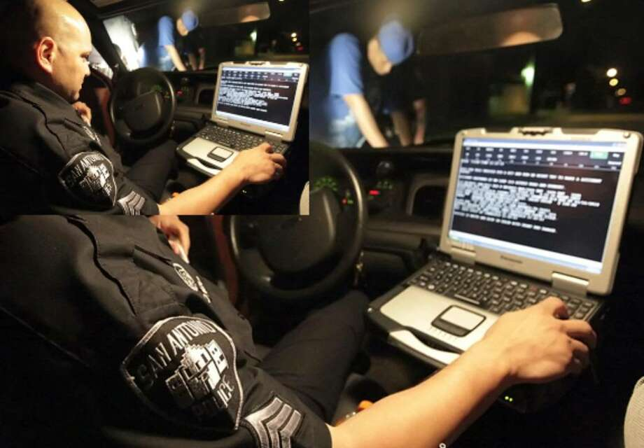 Sgt. Tom Alonzo does a background check from his in-car computer as part of the Police Department's Problem Oriented Policing unit. The new POP program also includes representatives from a number of other city services.