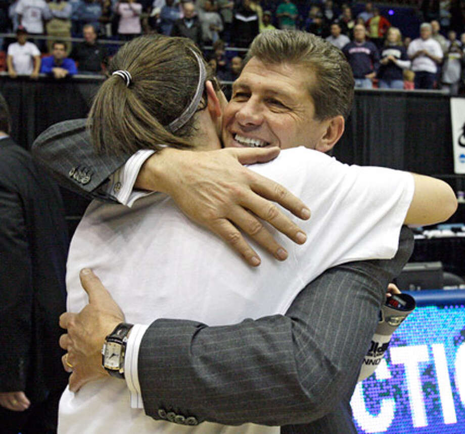 Connecticut coach Geno Auriemma hugs guard Kelly Faris after the Huskies beat Florida State on Tuesday in the Dayton Regional to reach the Final Four at the Alamodome. The Huskies have won 76 straight and are the favorites to repeat as national champions.
