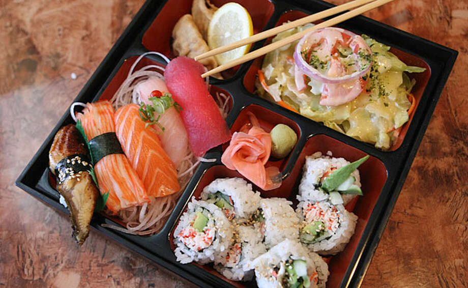 Lunch combo No. 3, presented in a bento box, lets the diner sample several of the restaurant's specialties.
