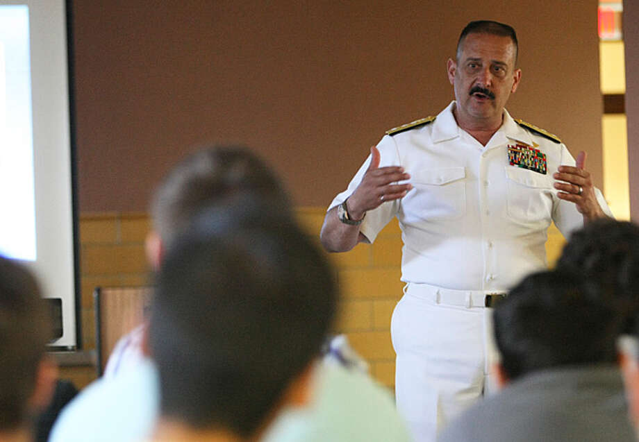 Rear Adm. Albert Garcia III tells students at his alma mater, Central Catholic High School, that educators helped shape his Navy career.