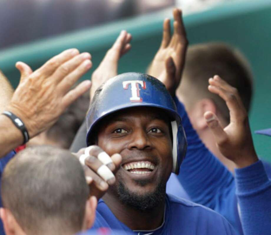 Texas' Vladimir Guerrero celebrates in the dugout after a two-run homer in the first inning.