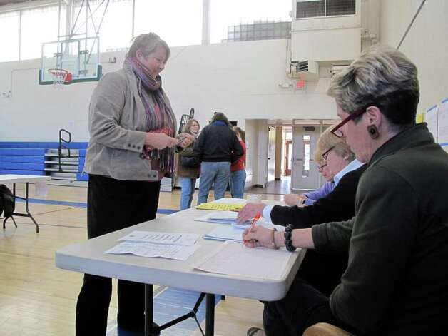 Michael Anne Chiodo checks in to vote ath the Town Hall voting site Tuesday afternoon. Photo: File Photo / Darien News