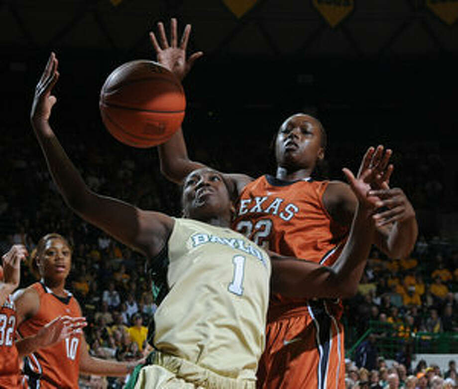 Baylor's Kimetria Hayden pulls down a rebound in front of Ashley Gayle, but it was the Longhorns who won the battle of the boards, 46-38. Texas also had eight blocks, while Baylor had four without Brittney Griner, who averages six per game.