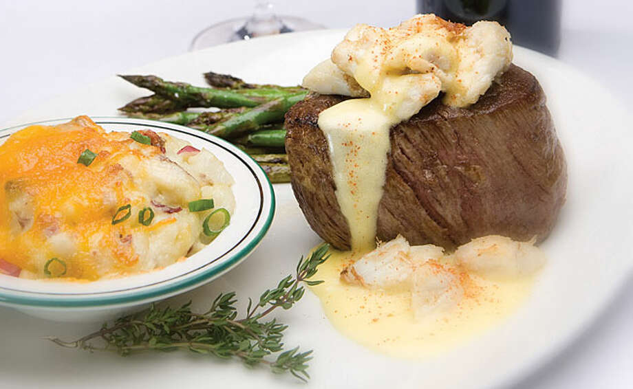 A filet mignon with crabmeat and hollandaise sauce with grilled asparagus and three-cheese potatoes is among the options at Palm Restaurant.