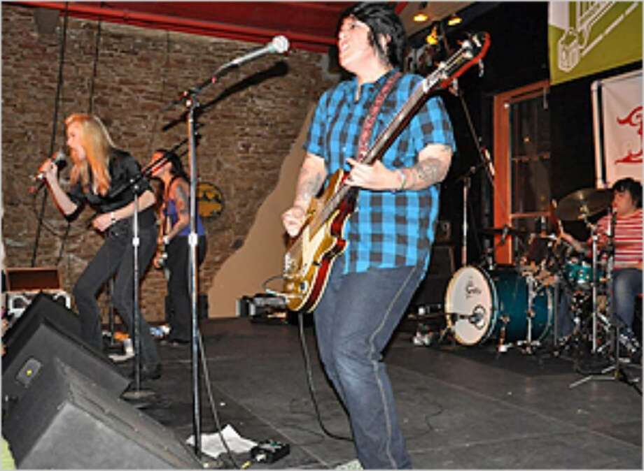 Girl in a Coma performs with ex-Runaways singer Cherrie Currie at SXSW in March.