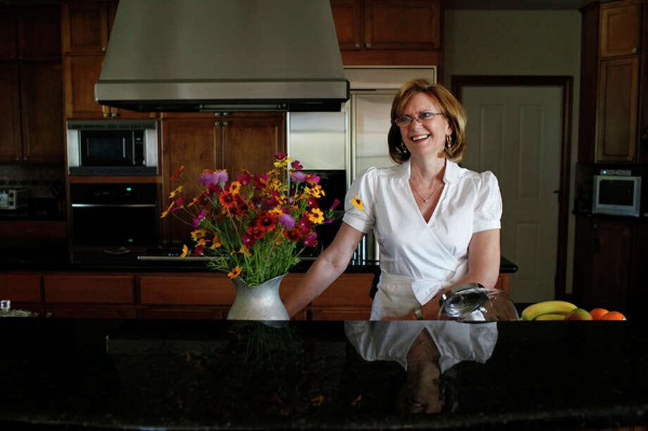 Mille Theis' kitchen features granite counters, maple cabinets and room for six cooks. She and her husband often entertain 50 or 60 guests at the family ranch in Yancey, in Medina County. / SAN ANTONIO EXPRESS-NEWS