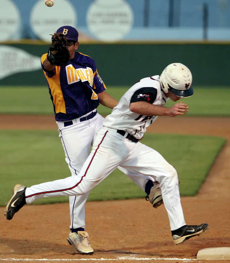 Churchill's Travis Jackson beats a throw to first base after McAllen's Omar Pompa bobbles the catch in the first inning in the Class 5A regional semifinal in Alice, Texas on Friday, May 28, 2010. McAllen defeated the Chargers, 6-0, to take Game 1. / San Antonio Express-News
