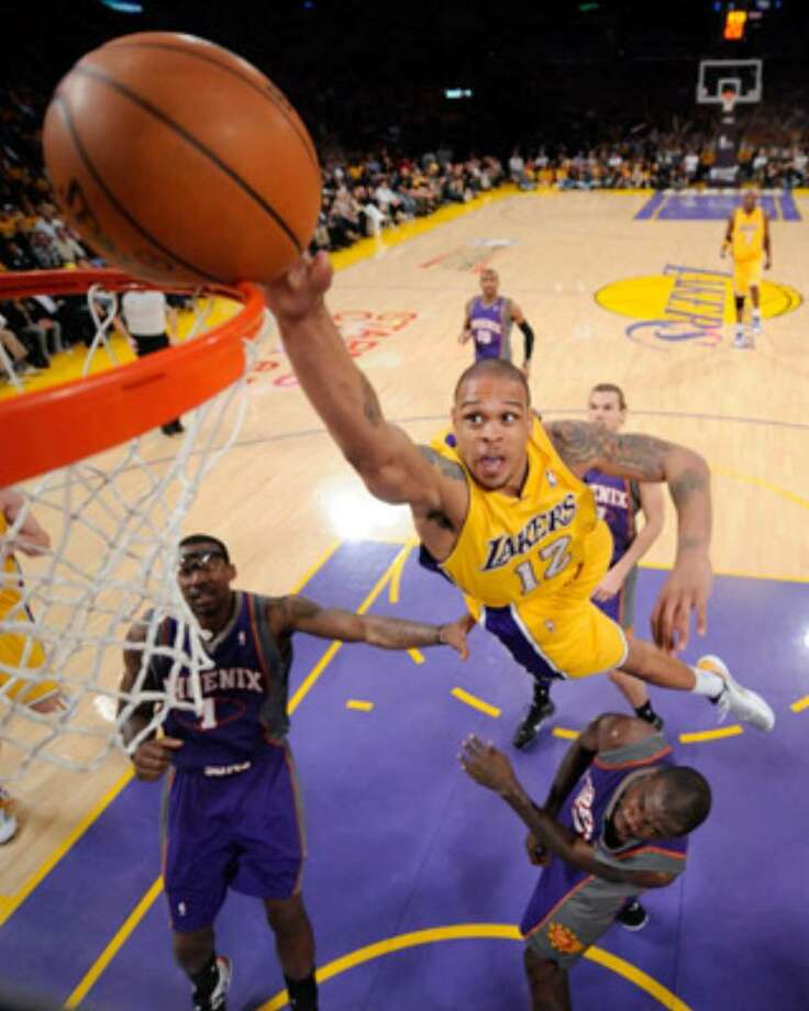 Lakers guard Shannon Brown attempts a dunk over the Suns' Amare Stoudemire (left) and Jason Richardson. Brown missed, but his teammates rarely did during the Game 1 victory.