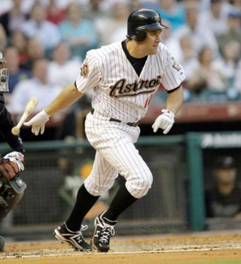 Astros first baseman Lance Berkman runs toward first base on an RBI groundout that scored Michael Bourn from third.