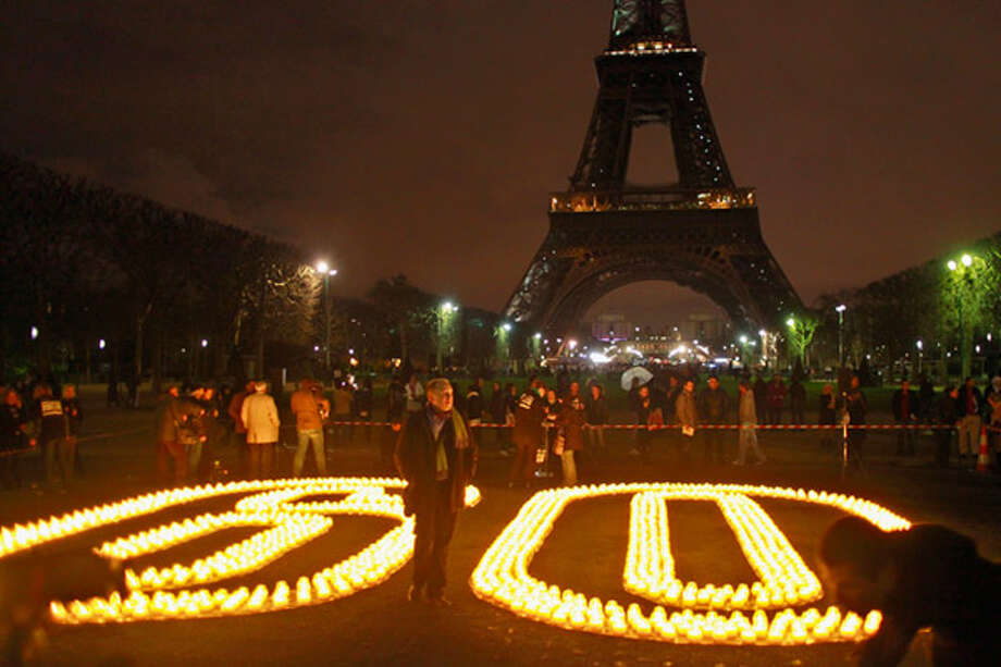 "FranceCandles forming the number ""60"" are seen in Paris as the Eiffel Tower sits darkened during the Earth Hour on Saturday, March 27, 2010."