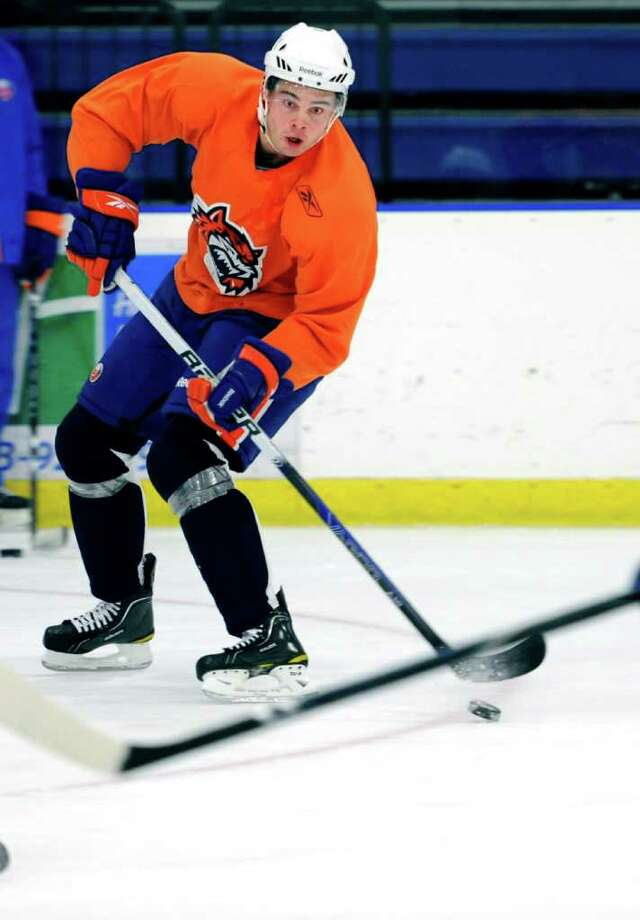 Jesse Joensuu passes the puck during Sound Tigers practice Wednesday Oct. 6, 2010 at The Rinks at SportsCenter of Connecticut in Shelton. Photo: Autumn Driscoll, ST / Connecticut Post