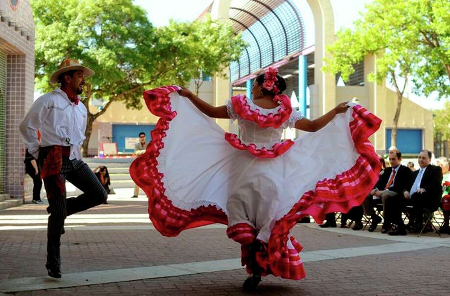 Carolina Guerra and Alvaro Duarte, dancers with the Compania Guadalupe, dance during the Cinco de Mayo celebration in Plaza Guadalupe on Wednesday.