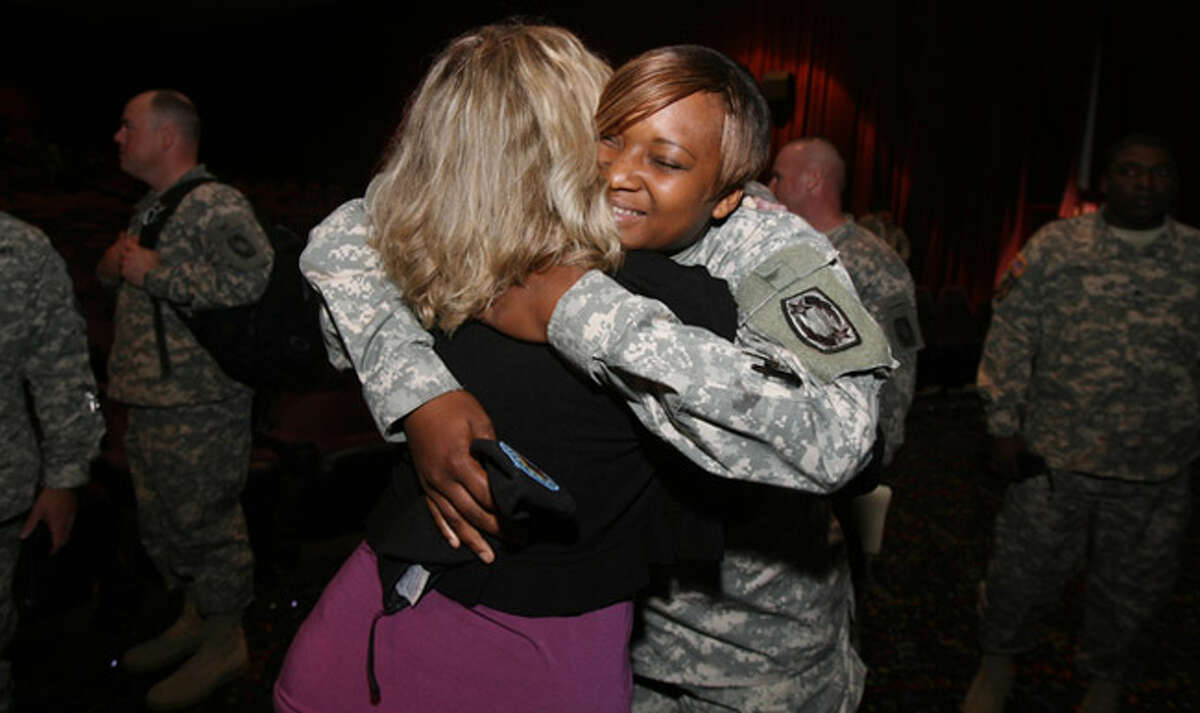 Sgt. Harmony Williams (right) hugs speaker Kim Ruocco after she spoke to soldiers at Fort Hood.