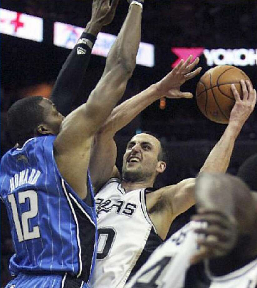 Manu Ginobili drives into the defense of Orlando's Dwight Howard. In addition to his first 40-point game in more than two years, Ginobili also had six rebounds and five assists Friday at the AT&T Center.
