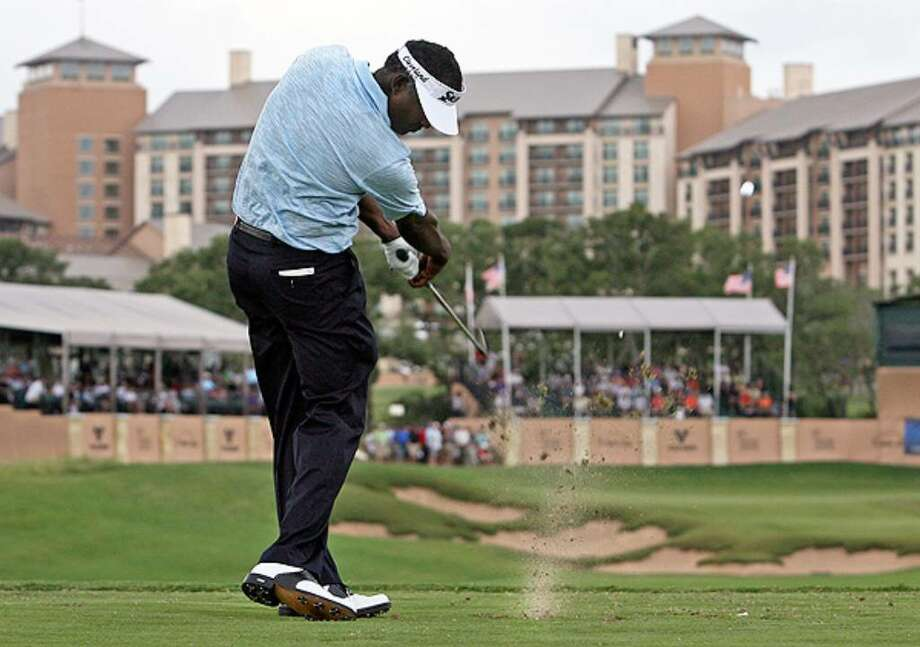 Vijay Singh hits into the 16th green Thursday during the first round of the Valero Texas Open.