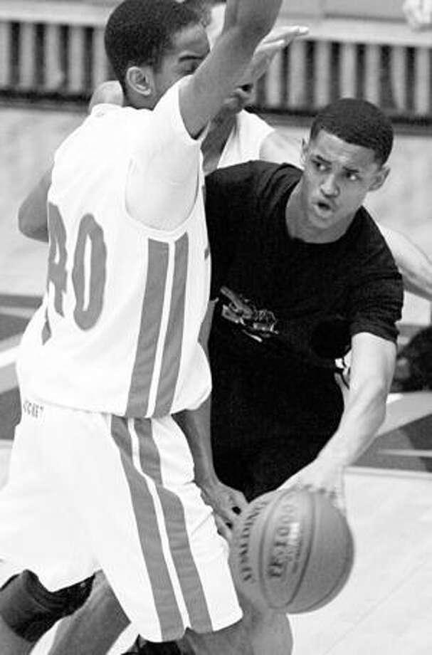 Wagner's Jordan Clarkson (right) looks to pass around Judson's Thurman McNeil during the Region IV-5A final.