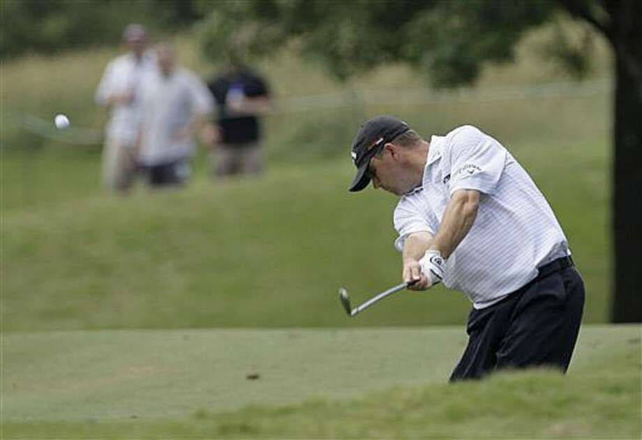 Cameron Beckman hits from the rough along the ninth fairway during the second round of the Byron Nelson Championship.