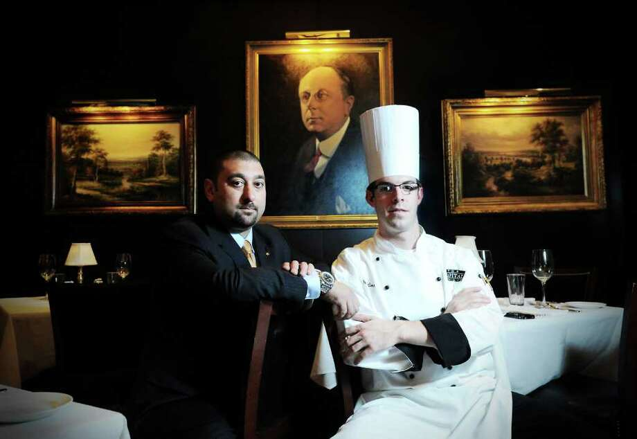 Greg Perna, managing partner, and Joseph, manager & chef, in the dining room at The Capital Grille in Stamford, Conn. on Tuesday October 26, 2010. Photo: Kathleen O'Rourke / Stamford Advocate