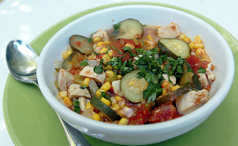 Calabacita with chicken makes a complete meal. Just add tortillas. / AJC