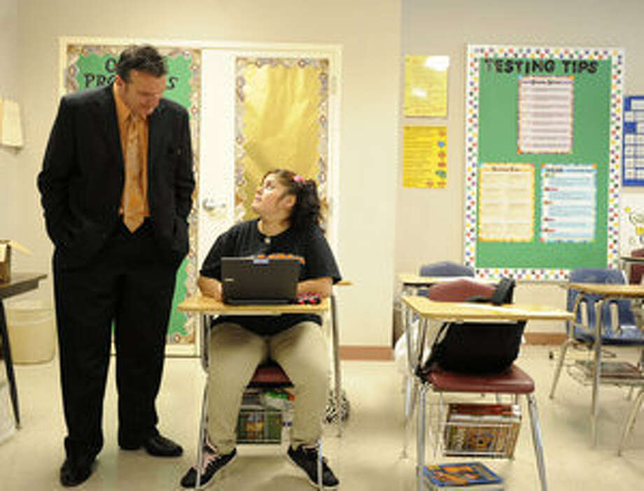 Twain Principal Gary Pollock speaks with Diana Ochoa, 15, in a Middle School Partners class. The program is for students two or more years older than most of their class.