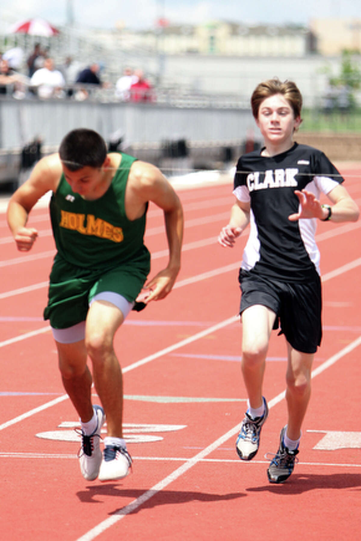 Holmes' Marco Arias just beats out Clark's Austin Wells to win the boys' mile.