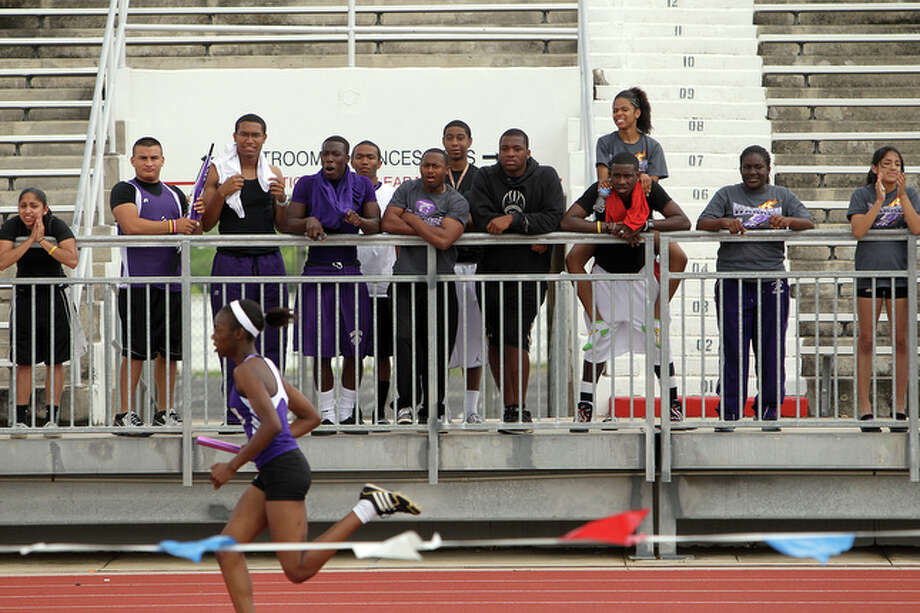 Warren students cheer on a member of their 4x4 relay team. / spoecial to the San Antonio Express-News