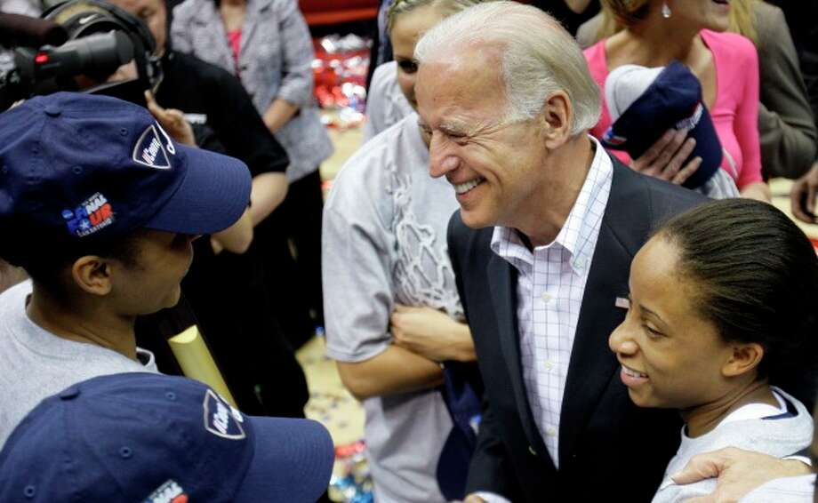 Vice President Joe Biden hugs Connecticut's Lorin Dixon as he congratulates her and teammates following the women's NCAA Final Four college basketball championship game against Stanford Tuesday.