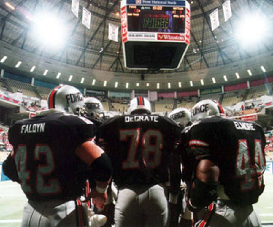 San Antonio Force players huddle moments before their first game in the since-demolished Hemisfair Arena in 1992. The team played one season in the Arena Football League before ceasing operations.