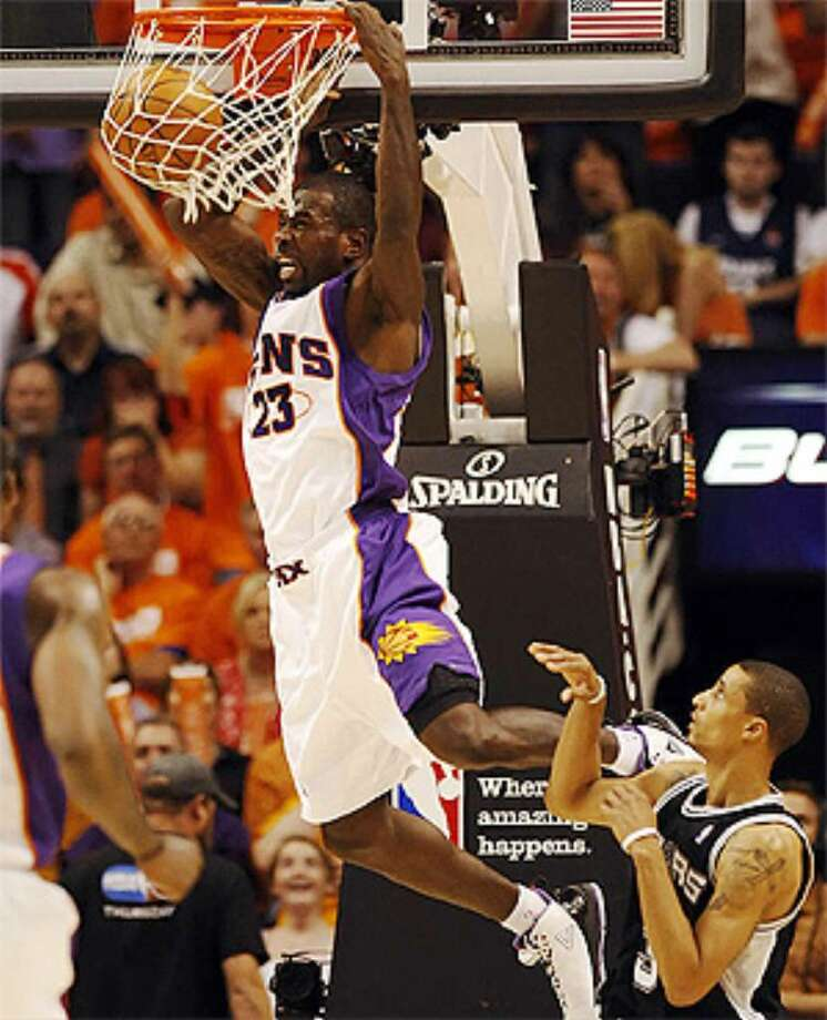 The Suns' Jason Richardson throws down a dunk in front of Spurs guard George Hill during the second half of Phoenix's Game 1 victory.