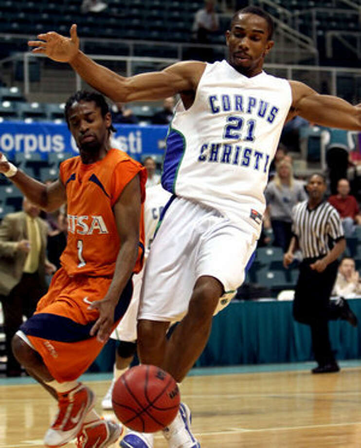 UTSA's Omar Johnson (left) tries to go around Texas A&M-Corpus Christi's Demond Watt for a loose ball.
