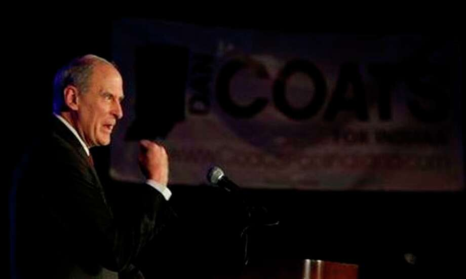 Republican candidate for U.S. Senate Dan Coats reacts after winning the nomination for the U.S. Senate seat in Indianapolis