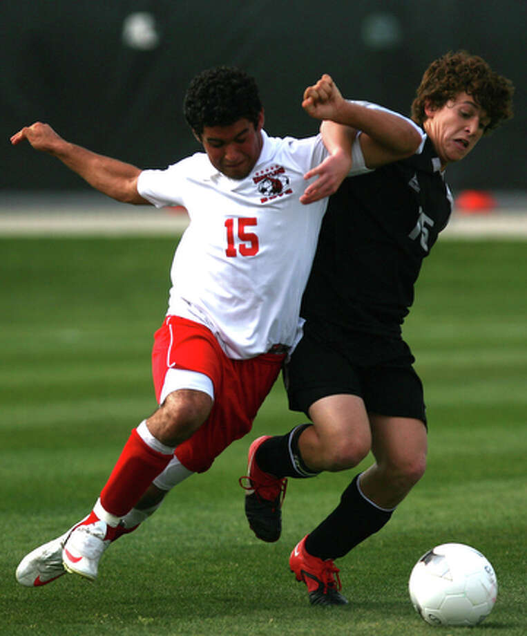 Sharyland's Ricky Mata defends against Clark's Carlos Sepulveda as Clark played Mission Sharyland in the region IV-5A boys soccer semifinal at Blossom Athletic Center, April 2, 2010. Clark won in a shootout 1-0. / spoecial to the San Antonio Express-News