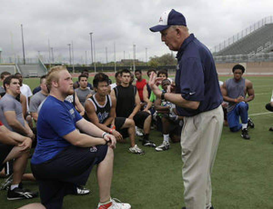UTSA head coach Larry Coker talks with prospective players after student tryouts on Wednesday at Farris Stadium.