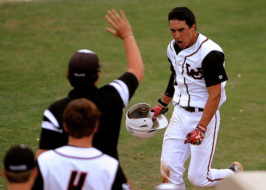 Churchill's Dustin Aguilar reacts after scoring to help his team defeat Stephen F. Austin, 8-6, in Class 5A bi-district boys baseball playoffs action.