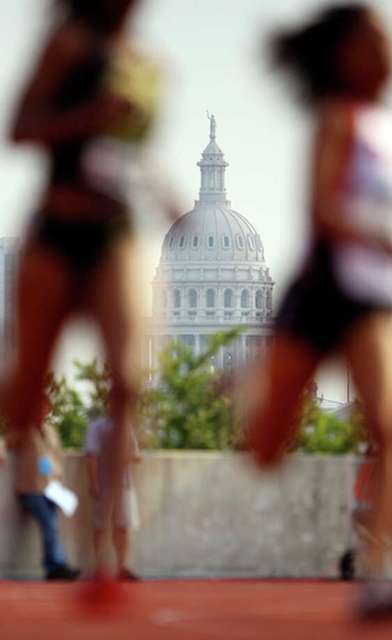 The Texas State Capitol dome is pictured behind contestants in the women's 400-meter dash during the West Preliminary of the NCAA Outdoor Track and Field Championships May 28, 2010 at Mike A. Myers Stadium in Austin, Tx. / eaornelas@express-news.net