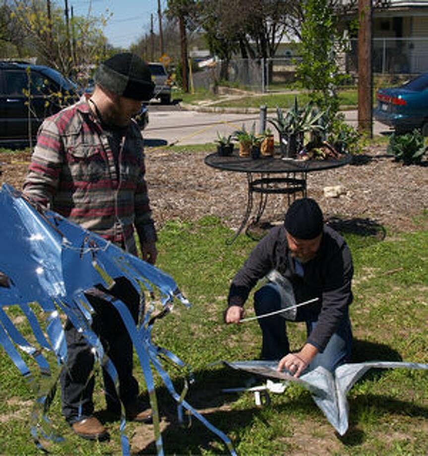 Chris Sauter and Rick Frederick assemble their kites at the Kite Festival at Pittman-Sullivan Park.