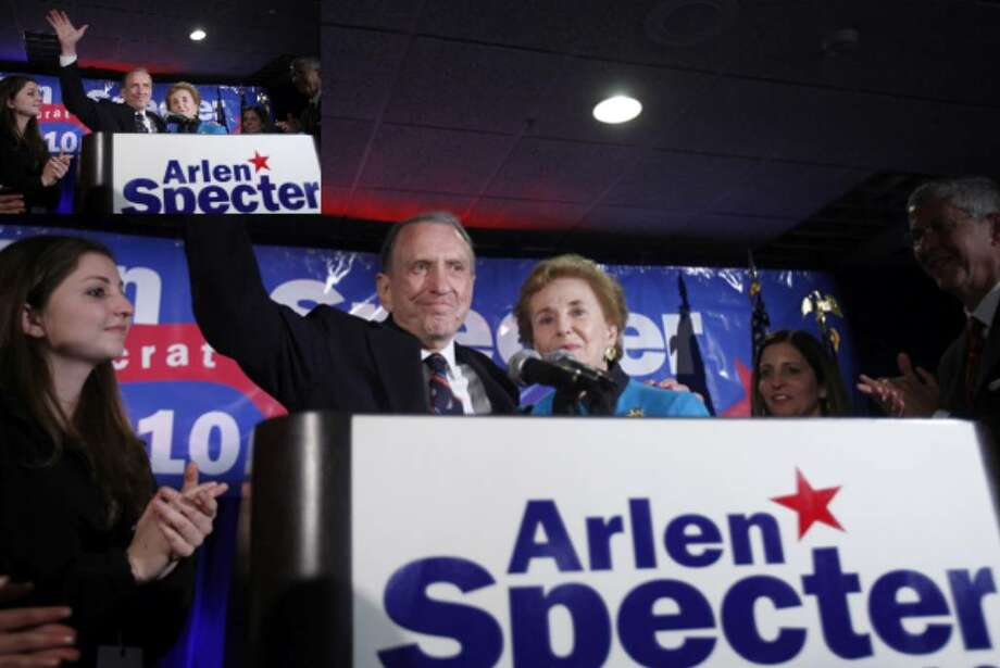 Sen. Arlen Specter, D-Pa., with wife Joan, waves as he gives his concession speech to supporters on May 18 in Philadelphia.