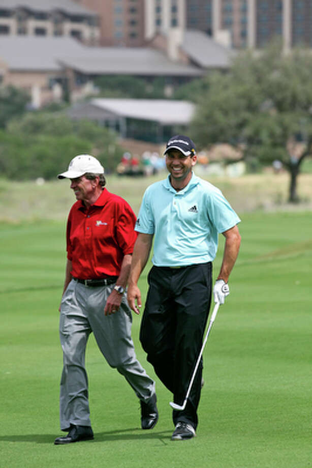 Sergio Garcia walks the 11th  fairway at the AT&T Oaks Course at TPC San Antonio with PGA Commisioner Tim Finchem during the Oak Farms Dairy Charity Pro-Am on May 12, 2010. / © 2010 San Antonio Express-News